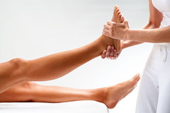 Osteopath massaging female foot. Stock Photos