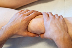 Osteopath's healing hands Stock Photos