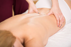 Osteopath treating young woman Stock Photography