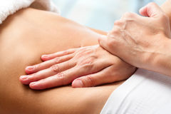 Osteopathic belly massage. Royalty Free Stock Photography