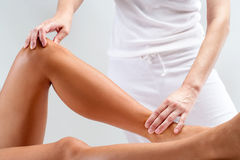 Osteopathic massage on female legs. Royalty Free Stock Images