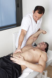 Osteopathy. Physical therapist with patient applying osteopathy Stock Image
