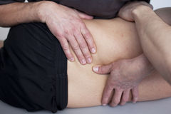 Osteopathy. Doctor with patient applying osteopathy Stock Photo