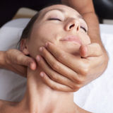 Osteopathy with cervical manipulation. Cervical manipulation on a female patient Royalty Free Stock Images