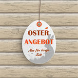 Osterangebot Egg Price Sticker Wood. Price sticker with german text Oster Angebot and Nur fuer kurze Zeit, translate Easter Offer and limited time only Royalty Free Stock Photography