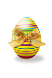 Osterei. Striped easter egg with a bow on white background stock illustration