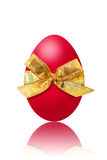 Osterei. Red easter egg with a bow on white background royalty free illustration