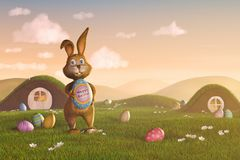 Osterhase, der hält ein Ei mit dem Wörter ` glücklichen Ostern-` Lizenzfreies Stockfoto