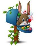 Osterhase mit Ostereiern und dem Briefkasten stock abbildung