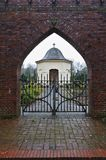 Osterholz-Scharmbeck, Germany - December 3rd, 2017 - View through the churchyard gate towards the funeral chapel stock photos