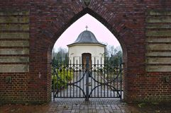 Osterholz-Scharmbeck, Germany - December 3rd, 2017 - View through the churchyard gate towards the funeral chapel. Osterholz-Scharmbeck, Germany - December 3rd Stock Photography