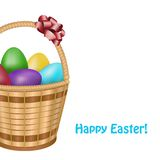 Ostern-Korb mit bunten Eiern Lizenzfreies Stockfoto