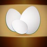 Ostern-Papiereier auf gestreiftem Hintergrund Stock Abbildung