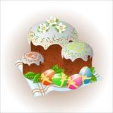 Ostern-Symbol Ostern-Kuchen und farbige Eier Stockfotos