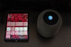 Smart home using an Apple HomePod speaker and the home app on the iPad royalty free stock photos