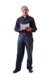 Ostinder-Mann, der eine iPad digitale Tablette verwendet Lizenzfreies Stockfoto