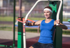Ostive Caucasian Female Athlete in Good Fit Having Workout Exercises Outdoor. Royalty Free Stock Photography