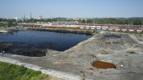 OSTRAVA, CZECH REPUBLIC, AUGUST 3, 2015: Former dump toxic waste, oil lagoon contamination water and soil Royalty Free Stock Images