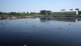OSTRAVA, CZECH REPUBLIC, AUGUST 3, 2015: Former dump toxic waste, oil lagoon contamination water and soil Royalty Free Stock Photos