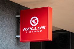 The logo of the Kellys bike company on a red banner near its retail shop and servicing centre