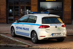 Ecologic and electric VW e-Golf police car of the Ostrava town police department parked in front of a store