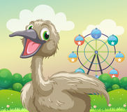 An ostrich in front of the ferris wheel. Illustration of an ostrich in front of the ferris wheel Royalty Free Stock Photography