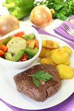 Ostrich steak with crispy baked potatoes Royalty Free Stock Photo