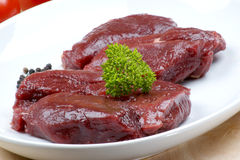 ostrich steak with parsley on a plate Stock Photo