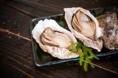 Ostriche arrostite - piatto famoso di Miyajima - Hiroshima - il Giappone Fotografia Stock