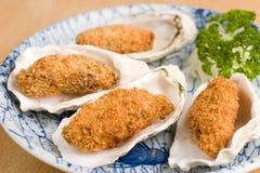 Ostriche impanate fritte nel grasso bollente giapponesi Fotografia Stock Libera da Diritti