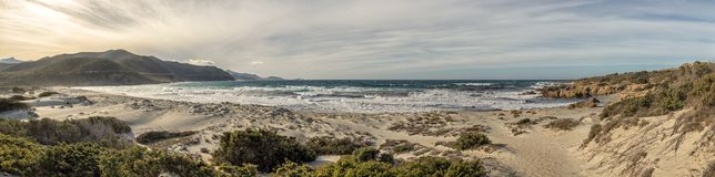 Ostriconi海滩全景在可西嘉岛 库存图片