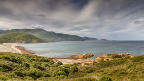 Ostriconi beach with Ile Rousse in background Stock Image