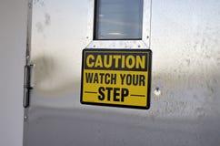 Ostrożność zegarek twój kroka znak na drzwi zdjęcie stock