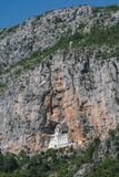 Ostrog monastery carved into the rock in Montenegro royalty free stock photography