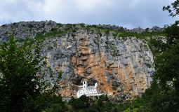 The Ostrog monastery high up in the large rock of Ostroška Greda - valley of Bjelopavlici royalty free stock photography
