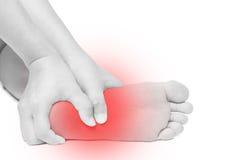 Ostry ból w stopie ręka masażu stopy odosobniony biel Zdjęcia Stock