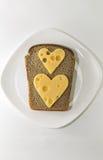 ostsmörgås på en vit platta Royaltyfri Fotografi
