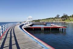 Oststrand-Schwimmen-Einschließung Stockfoto