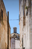 Ostuni lane in the Old Town. (the White City) with a dome in the background, Puglia, Italy Stock Image