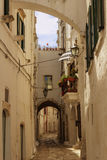 Ostuni: Sstroll through the narrow alleys where white houses are dotted Stock Photography