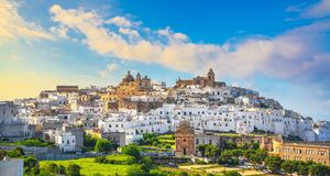 Ostuni white town skyline at sunset, Brindisi, Apulia, Italy royalty free stock photography