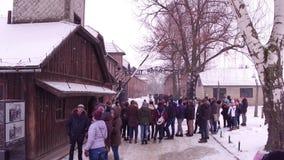 OSWIENCIM, POLAND - JANUARY, 14, 2017 Guided tour near entrance to Auschwitz Birkenau, German Nazi concentration and. OSWIENCIM, POLAND - JANUARY, 14, 2017 Royalty Free Stock Photo
