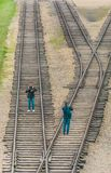 Oswiencim, Poland - September 21, 2019: Photographes takes pictures along the train line where the wagons arrived with stock photography
