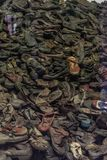 Oswiencim, Poland - September 21, 2019: Stack of shoes who once belonged to the jews and other prisoners from Auschwitz royalty free stock photo