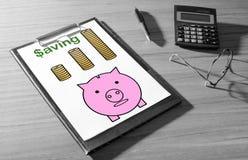 Oszczędzania pojęcie na biurku zdjęcia stock