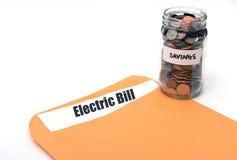 Oszczędzanie pieniądze na elektrycznym lub kosztach energii zdjęcia stock
