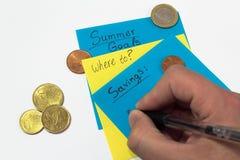 Oszczędzanie pieniądze plan, strategia dla lato ręki pisze na papierze zdjęcie stock