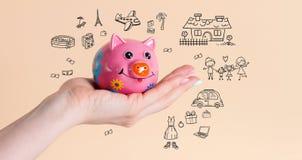 Oszczędzanie pieniądze prosiątka bank dla sen obrazy royalty free