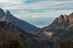 Ota in Corsica with mountains and Mediterranean sea Stock Images