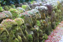 The stone of statues at rain day. The Otagi Nenbutsu ji Temple, Kyoto, Japan Royalty Free Stock Images